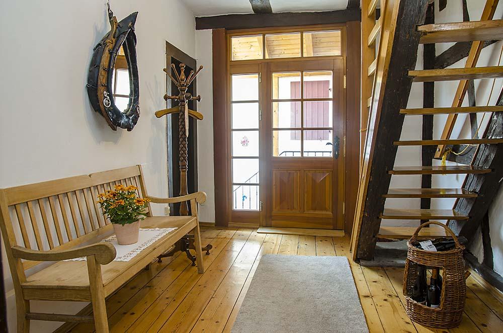 Eingangsbereich mit rustikaler Diele - Fewo Meerspinne, Gästehaus Meerspinne